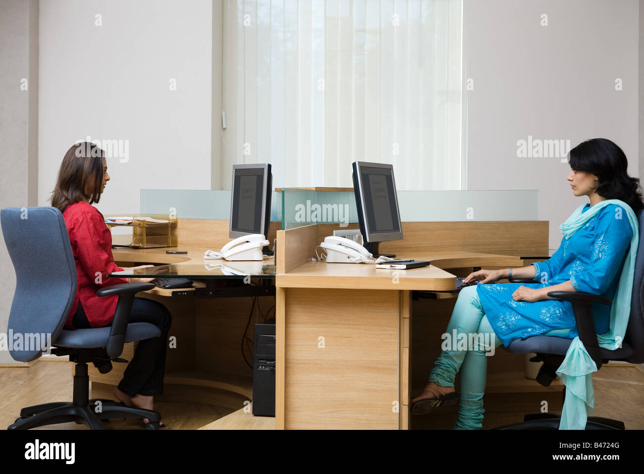 Female indian office colleagues - Stock Image