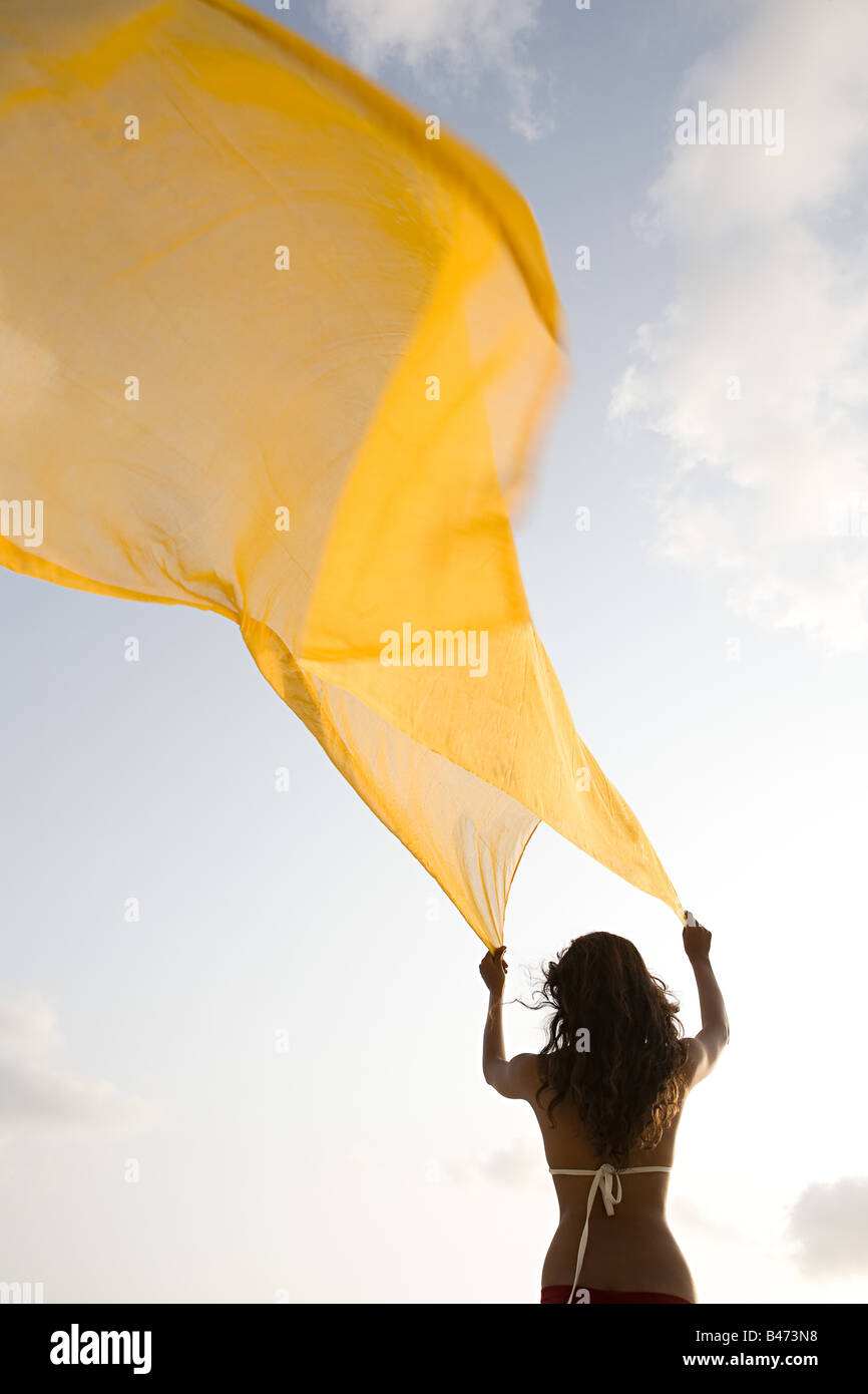 Woman with yellow cloth - Stock Image