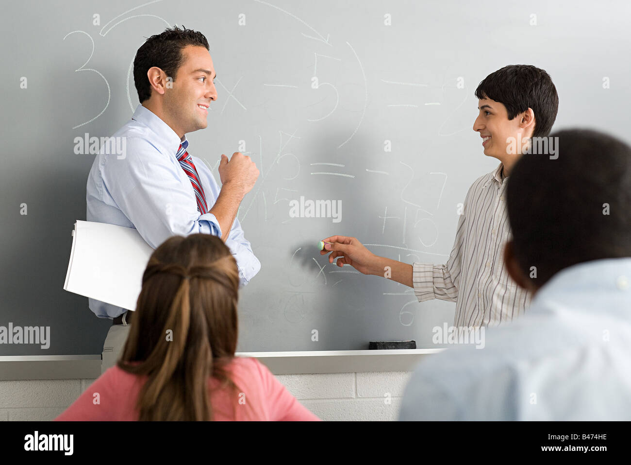 A teacher and a highschool student - Stock Image