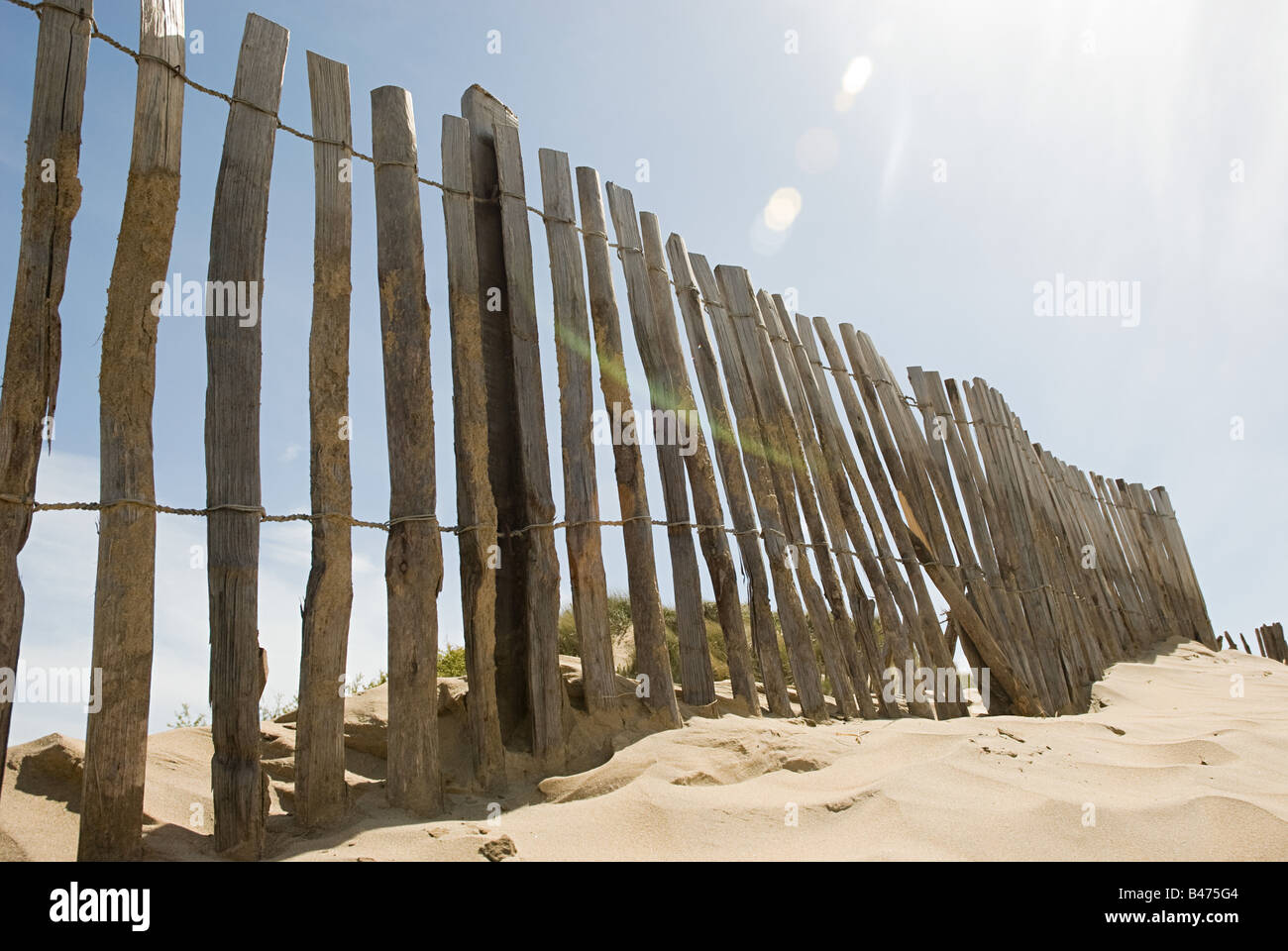 Fence on a beach - Stock Image