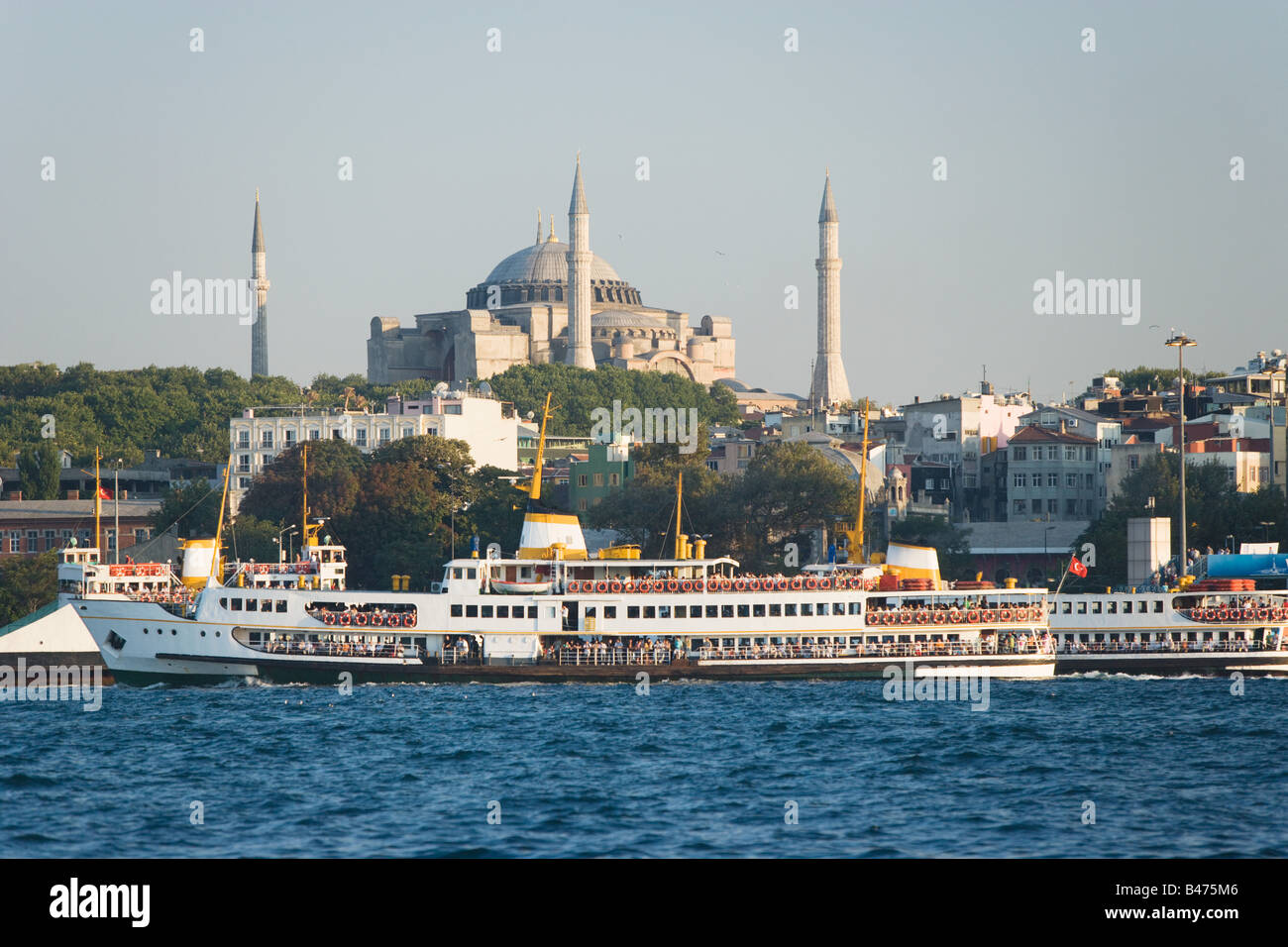 Boat on golden horn and hagia sofia - Stock Image
