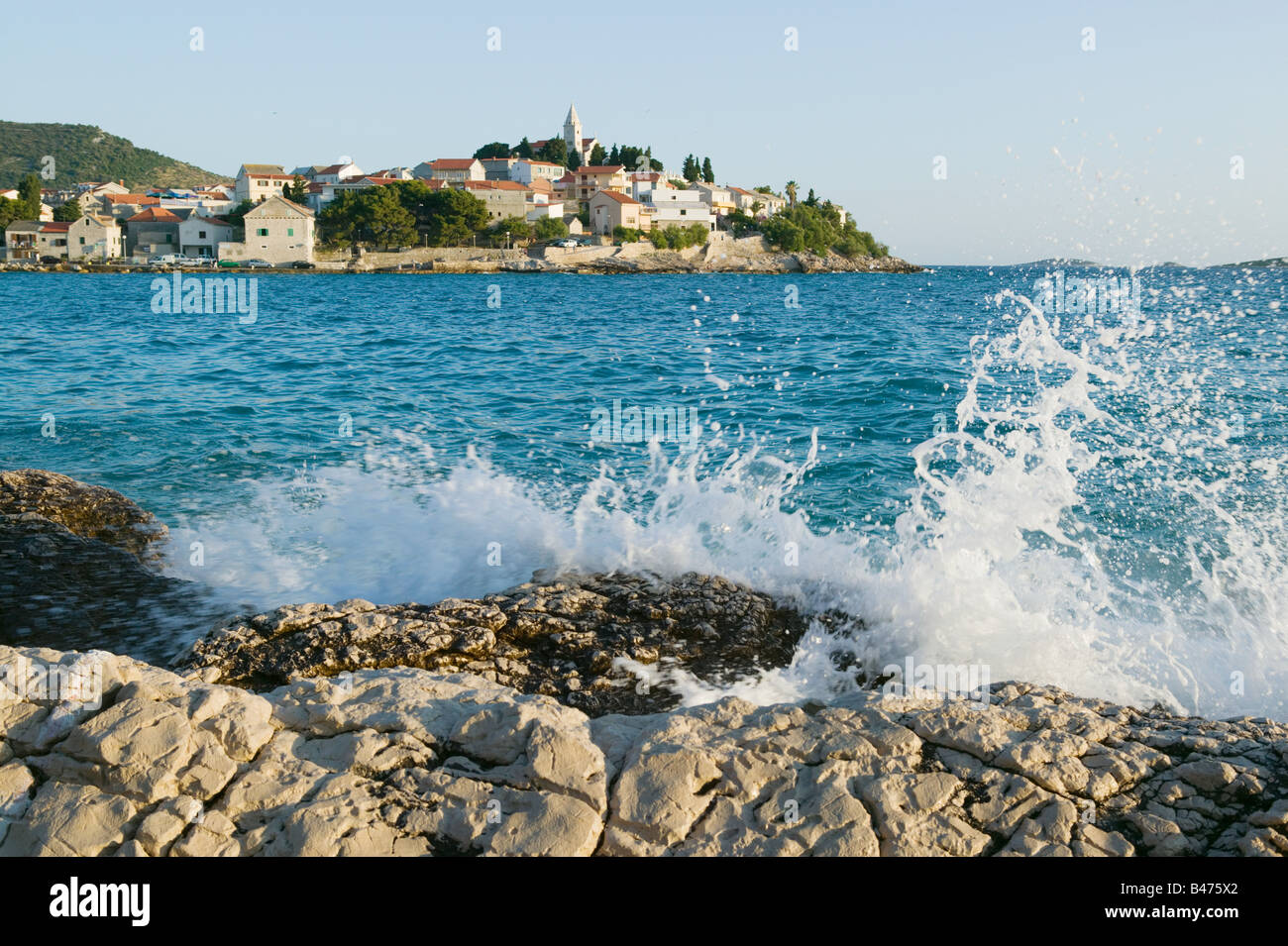 Sea splashing rocks at primosten Stock Photo