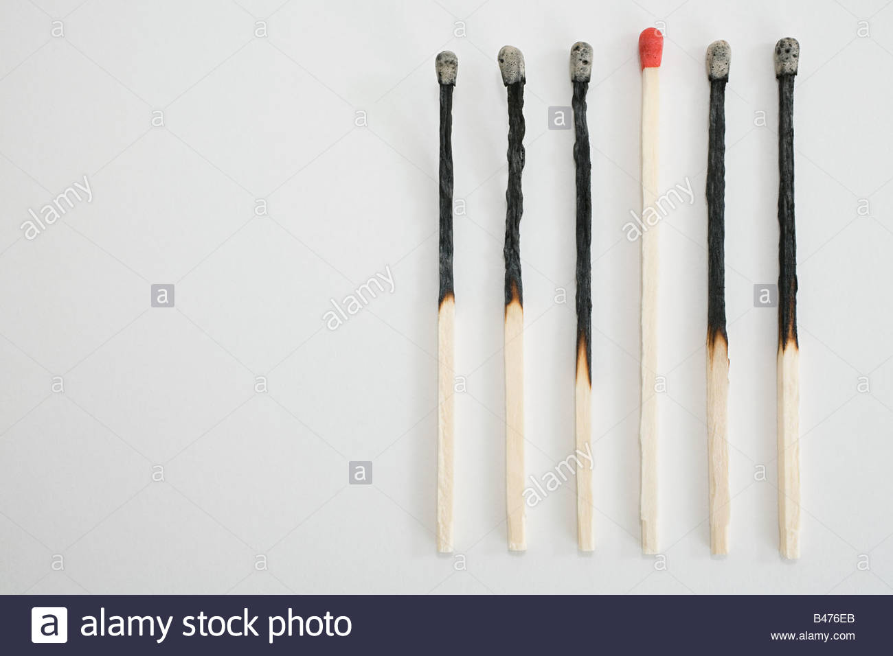 An unlit and burnt matches in a row Stock Photo