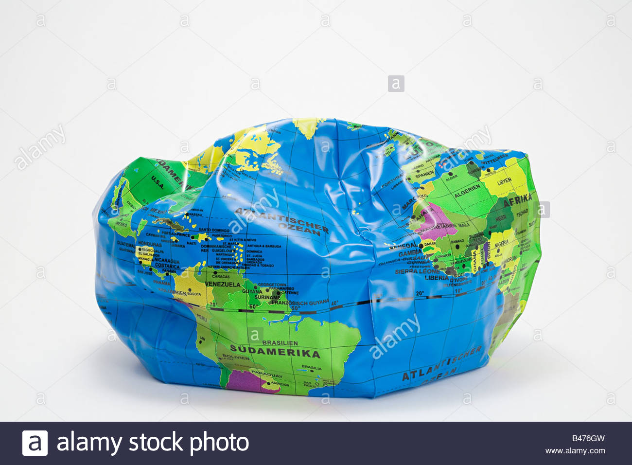 A deflated globe beach ball - Stock Image