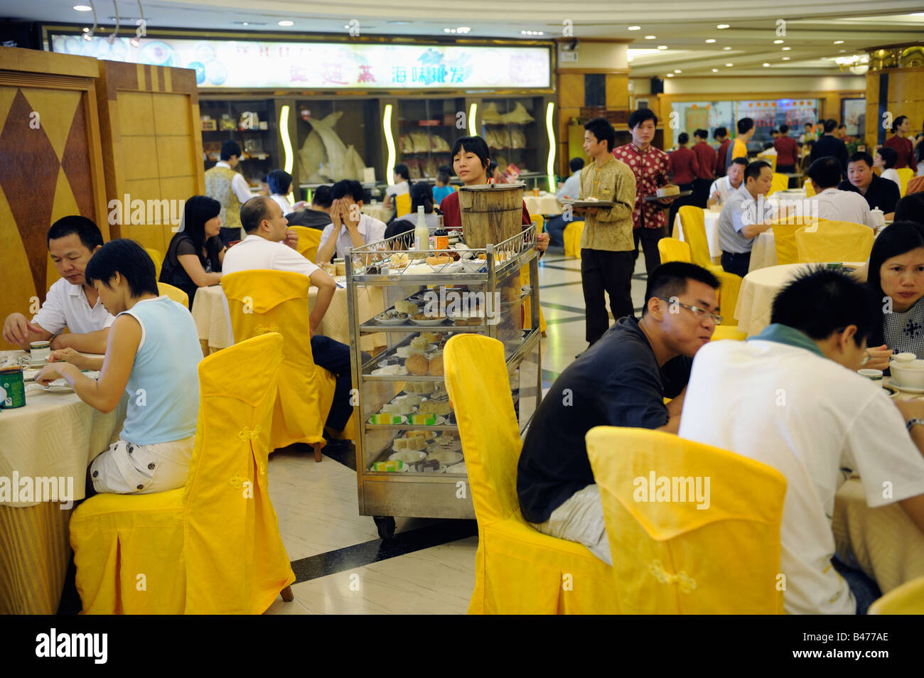 People have Cantonese Dim Sum with tea in a restaurant in Dongguan, Guangdong, China. 20-Sep-2008 - Stock Image