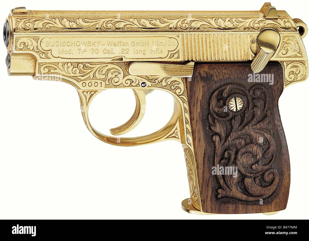 A Korriphila TP 70 in gilded finish with factory engraving, cal..22. Serial No. 0001. There are two lines on the - Stock Image