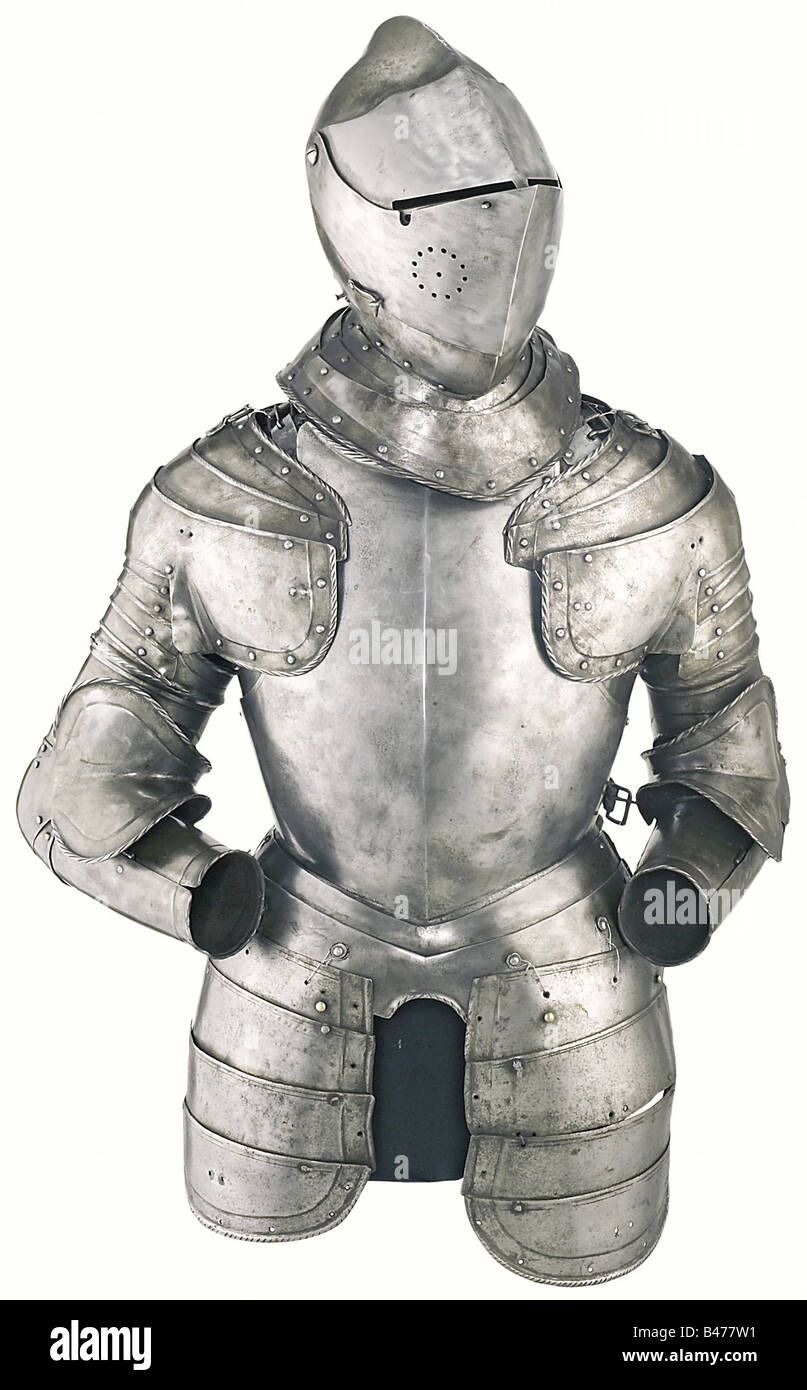 A bright suit of armour, Northern Italy, third quarter of the 16th century. Closed helmet with heavy skull forged - Stock Image