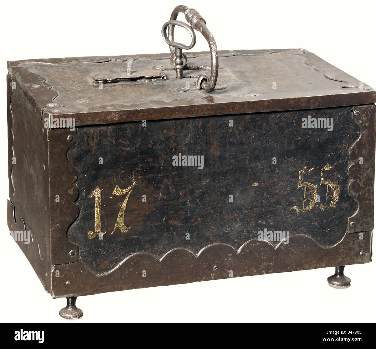 A German iron casket, dated 1755. A massive casket decorated with curved iron mountings on the edges, the covered - Stock Image