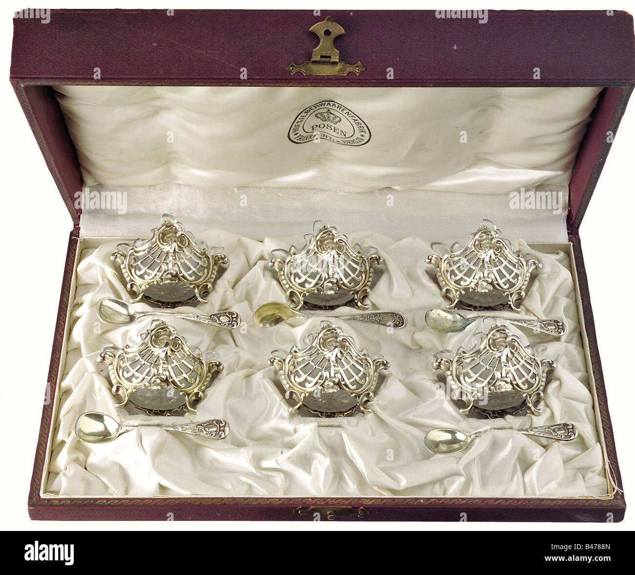 Empress Auguste Victoria - six small silver salt dishes in a chest., Openworked silver dishes in the Rococo style. Stock Photo