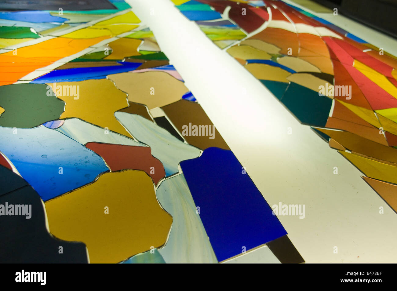 New stained glass window under construction - glass panels have been cut to size and arranged in position - Stock Image