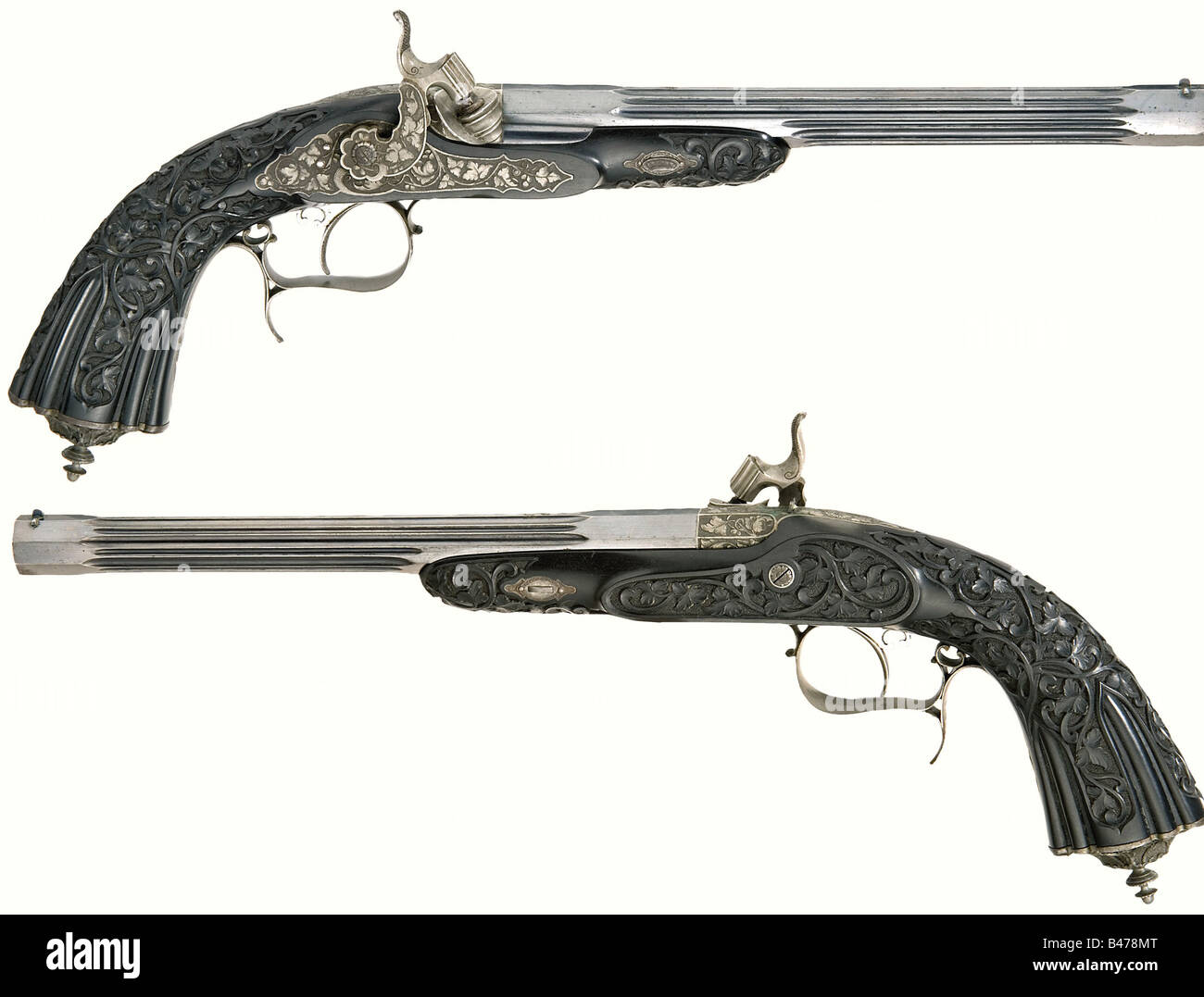 A cased pair of fine percussion pistols, Liège, circa 1850. Octagonal, fluted blued barrels with patent breechblock - Stock Image