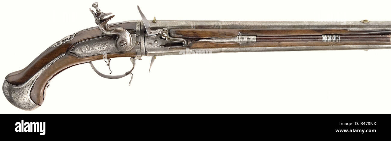 A double-barrel turnover flintlock pistol, Gilles Desellier, Liège, end of the 17th century. Two octagonal - Stock Image
