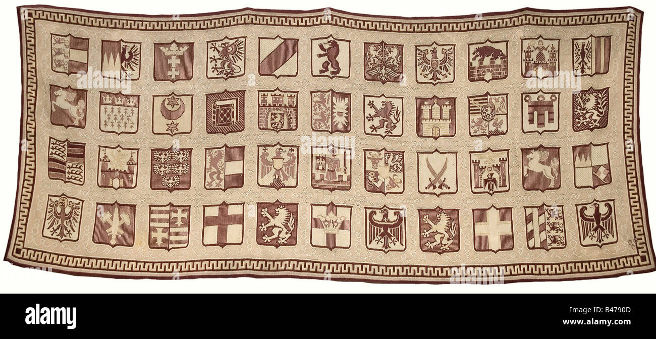 A wall tapestry with the 44 coats of arms for the NS-Gaue., In brown shades of hand woven wool, interwoven with - Stock Image