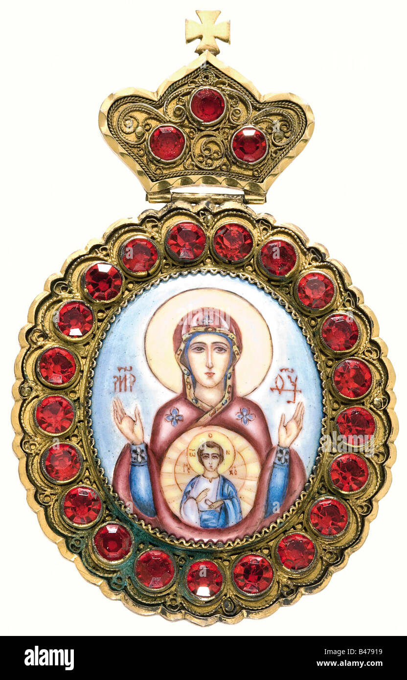 A pectoral of the Russian Orthodox Church., Gilded silver oval medallion (70 x 116 mm) set with red glass stones, - Stock Image