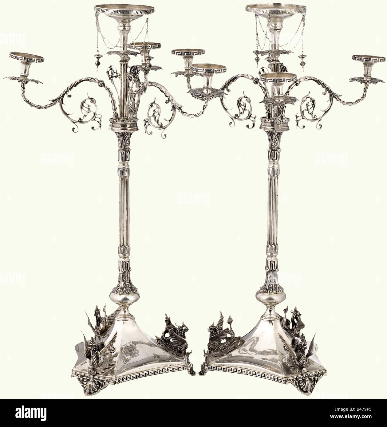 A pair of German ceremonial candelabras, end of the 19th century. Made in several pieces, with four candle holders, - Stock Image