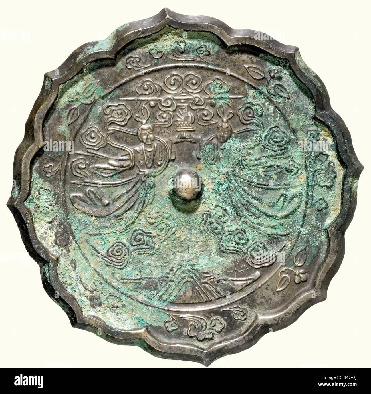 A bronze mirror, China, Tang Dynasty, 9th century A.D. Cast white bronze with a reinforced, palmate shaped rim and - Stock Image
