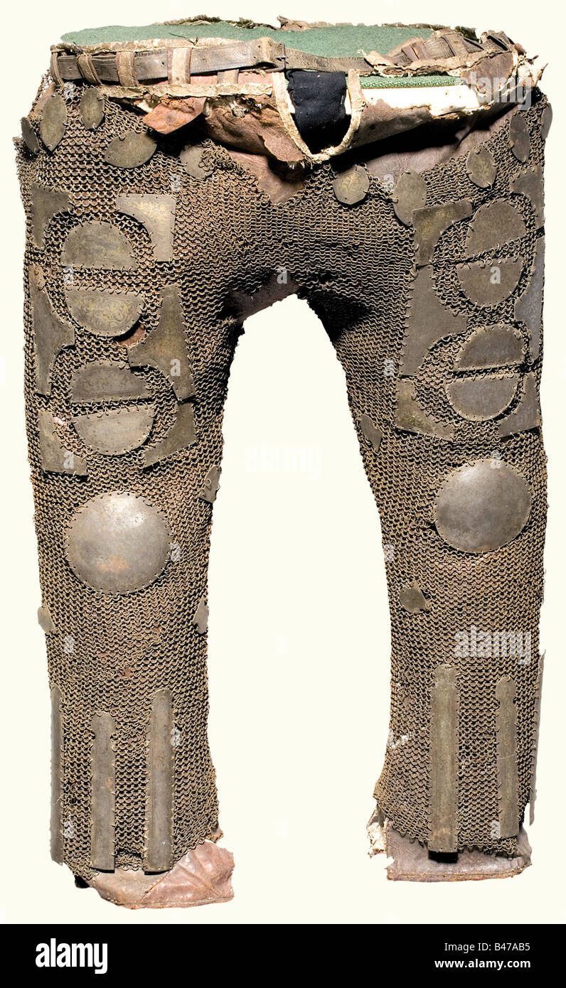 Armoured trousers, Persian, 19th century Ankle-length, linen-lined, leather trousers completely covered with iron - Stock Image