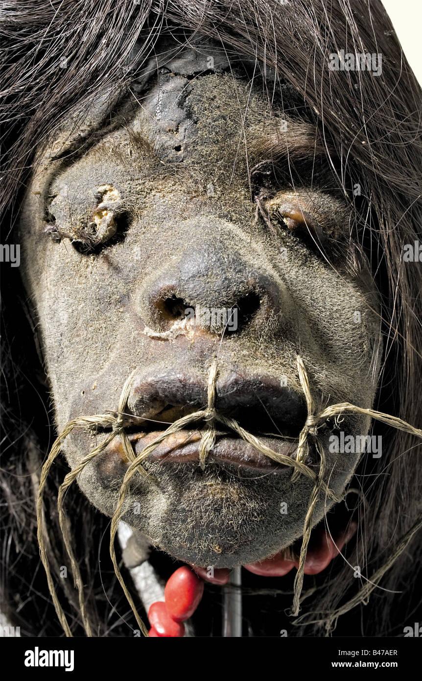 A tsantsa (shrunken head), of the Jivaro Indians, circa 1910 South America, Upper Amazon Region. Long black hair, - Stock Image