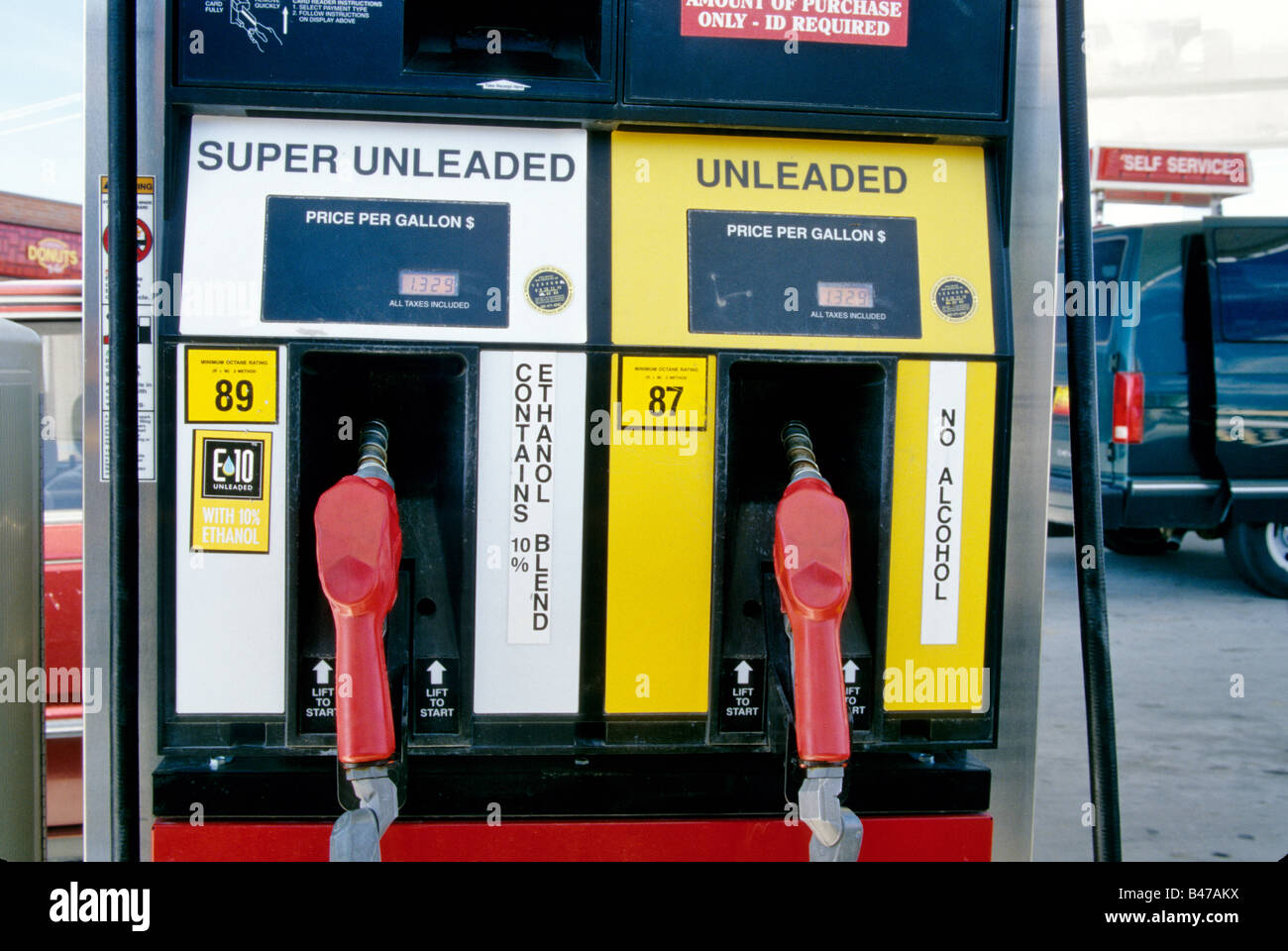 Ethanol gasoline pumps at service station. - Stock Image