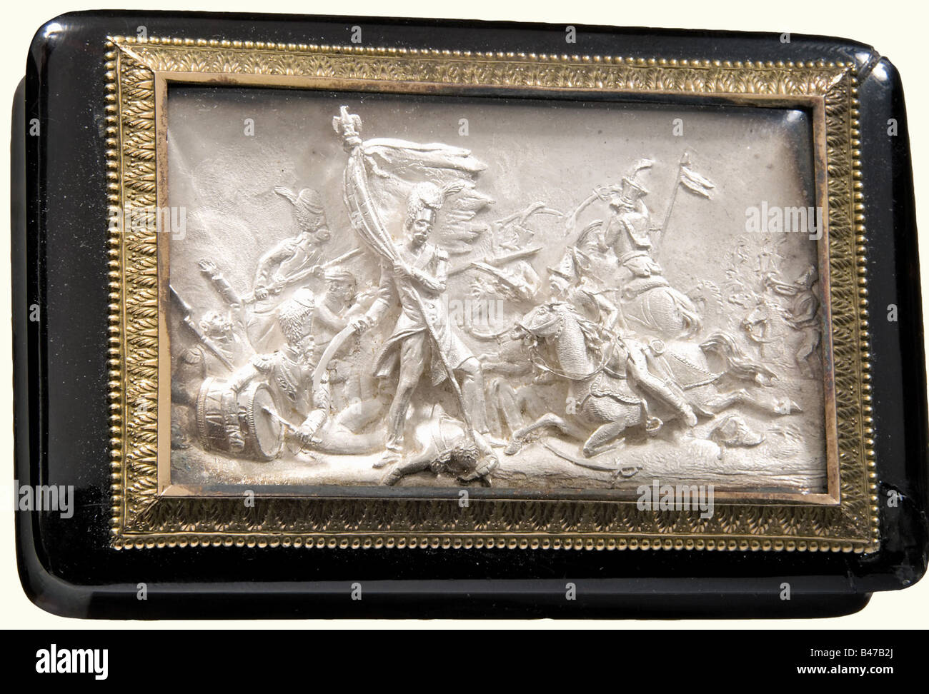 A French snuffbox with a battle scene, circa 1840. A rectangular snuffbox of black horn or tortoise shell. Two corners - Stock Image