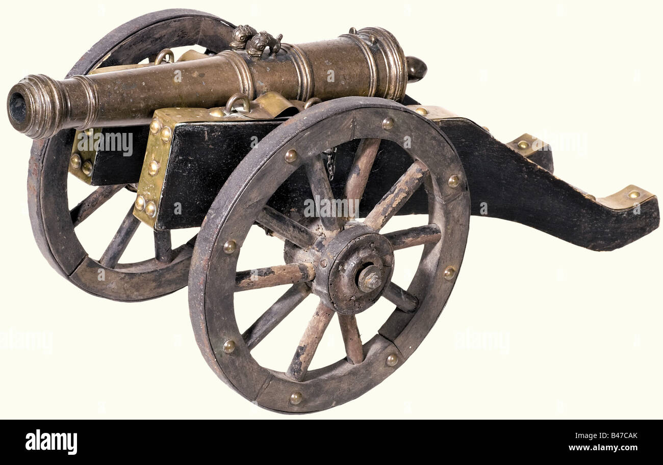 A pair of model cannons, German, circa 1700. Bronze barrels in several sections with hoop structure and reinforced - Stock Image
