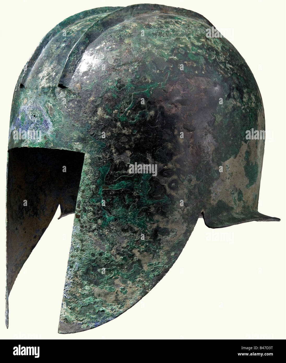 An Illyrian helmet, 5th century B.C. Bronze with greenish patina. High embossed skull with position for the crest - Stock Image