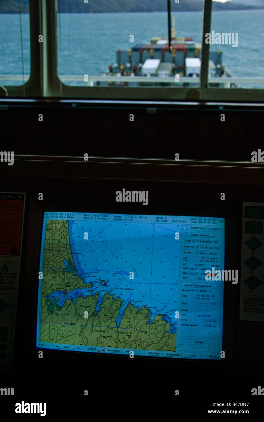 Electronc chart display on the bridge of a container ship entering Lyttelton Harbour, New Zealand. - Stock Image