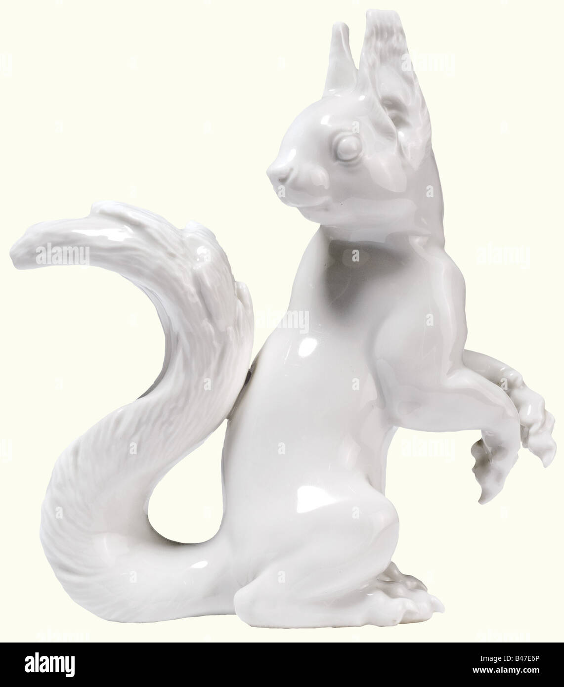 A squirrel., White porcelain. Base signed 'T. Kärner', model number '68', and green underglaze - Stock Image