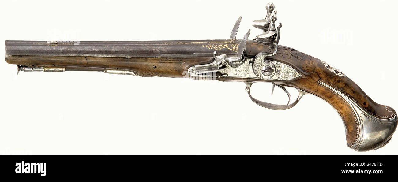 A pair of double-barreled flintlock pistols, Andre à Nancy, circa 1740/50. Round, smooth bore barrels in 13.5 - Stock Image