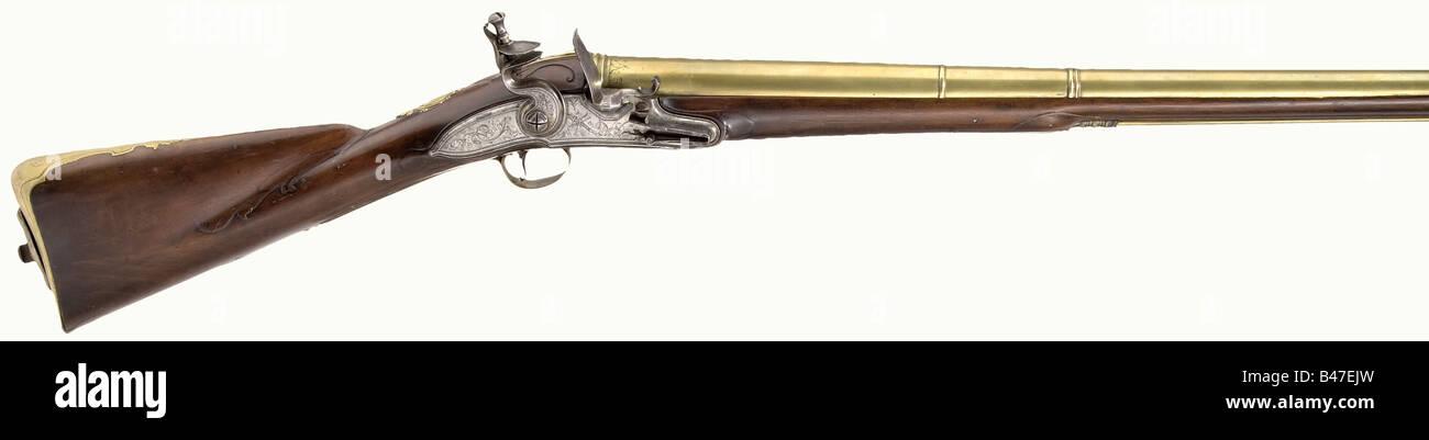An English muzzle-loading air gun with air reservoir and integral air pump, circa 1735. Massive brass barrel divided - Stock Image