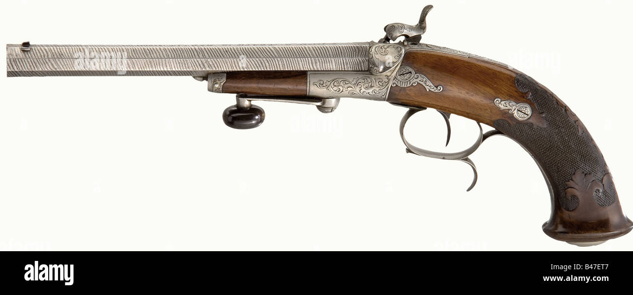 A cased pair of breech-loading percussion pistols, G. Noack, Berlin, circa 1860. Octagonal etched Damascus barrels - Stock Image