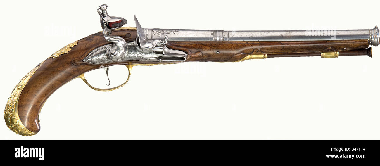 A fine flintlock pistol, Claude Niquet in Liège, circa 1740. Round, stepped barrel with cut scroll and beaded - Stock Image