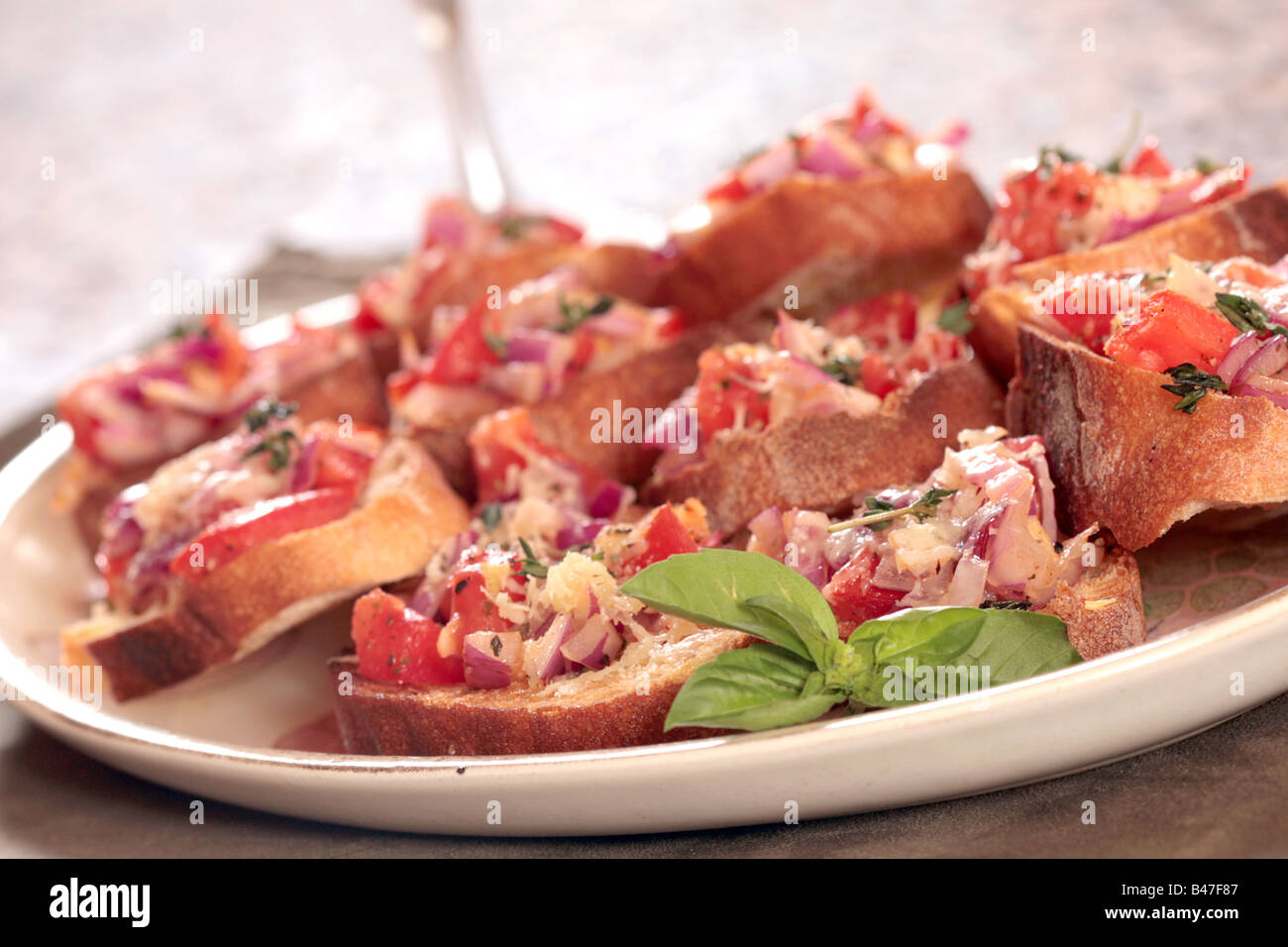 Plate of Bruschetta Appetizer Waiting to Be Eaten - Stock Image