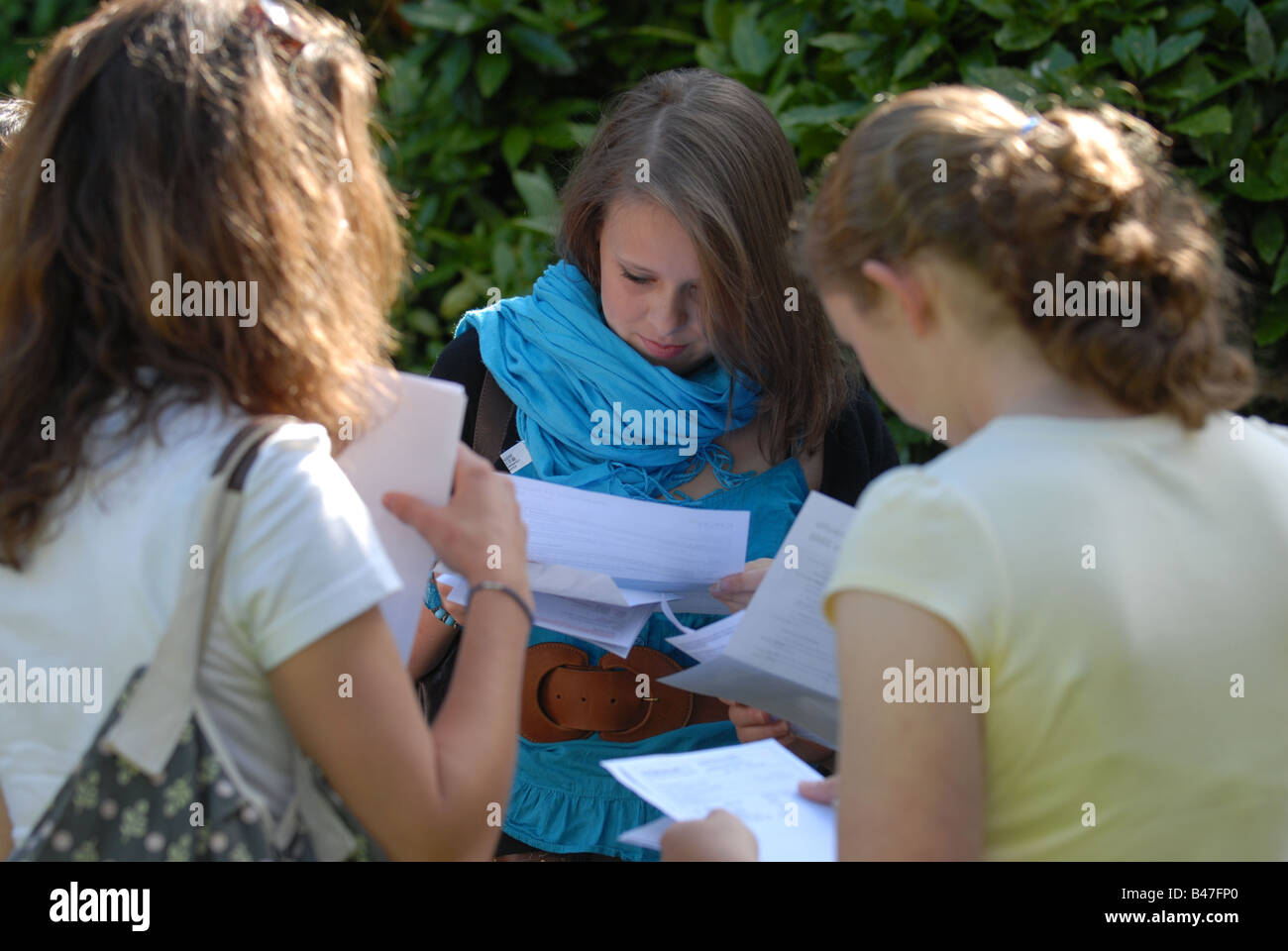 Pupils receive their GCSE results - Stock Image