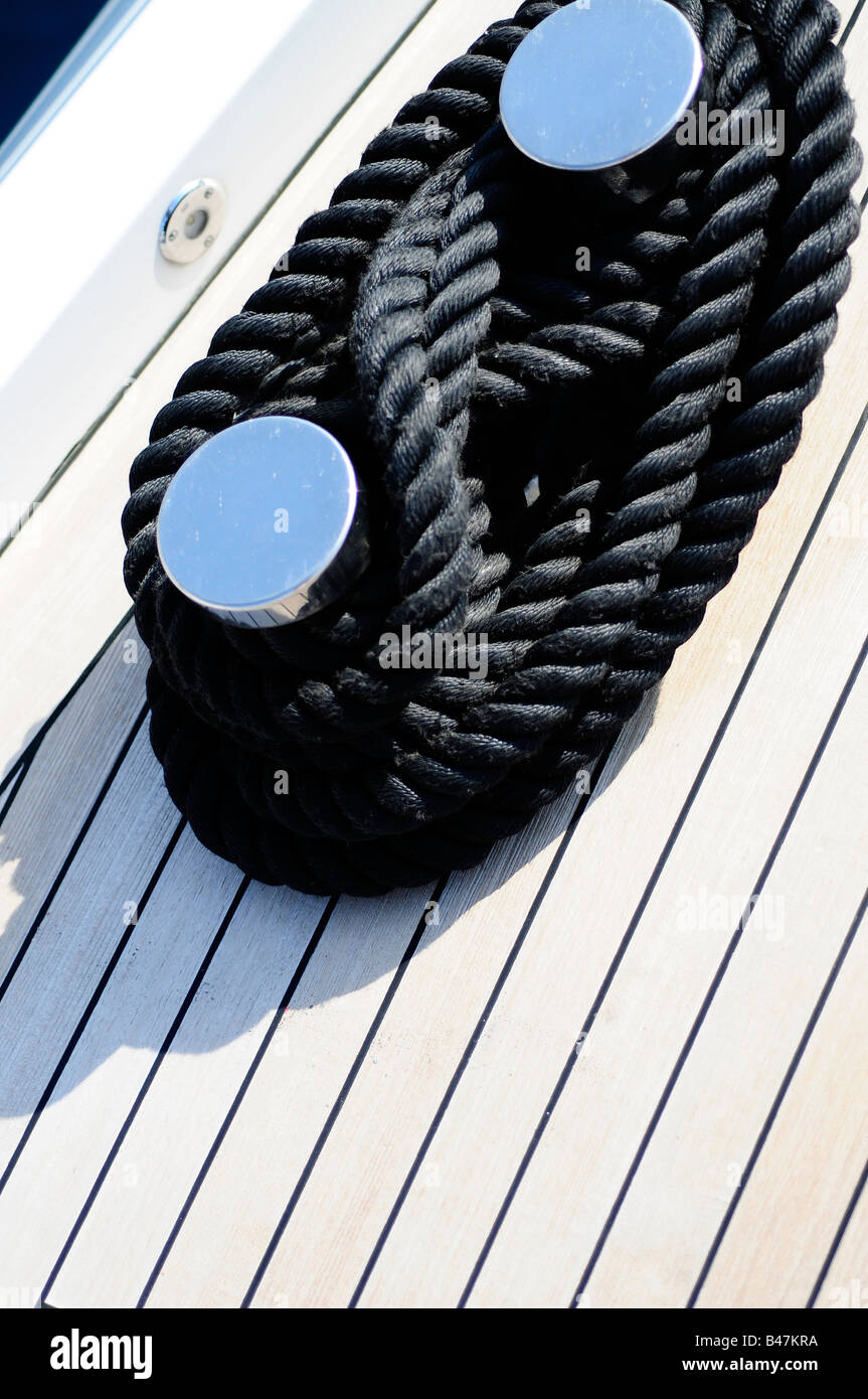 Ropes tied the teak deck of a super yacht. Picture by Patrick Steel patricksteel - Stock Image