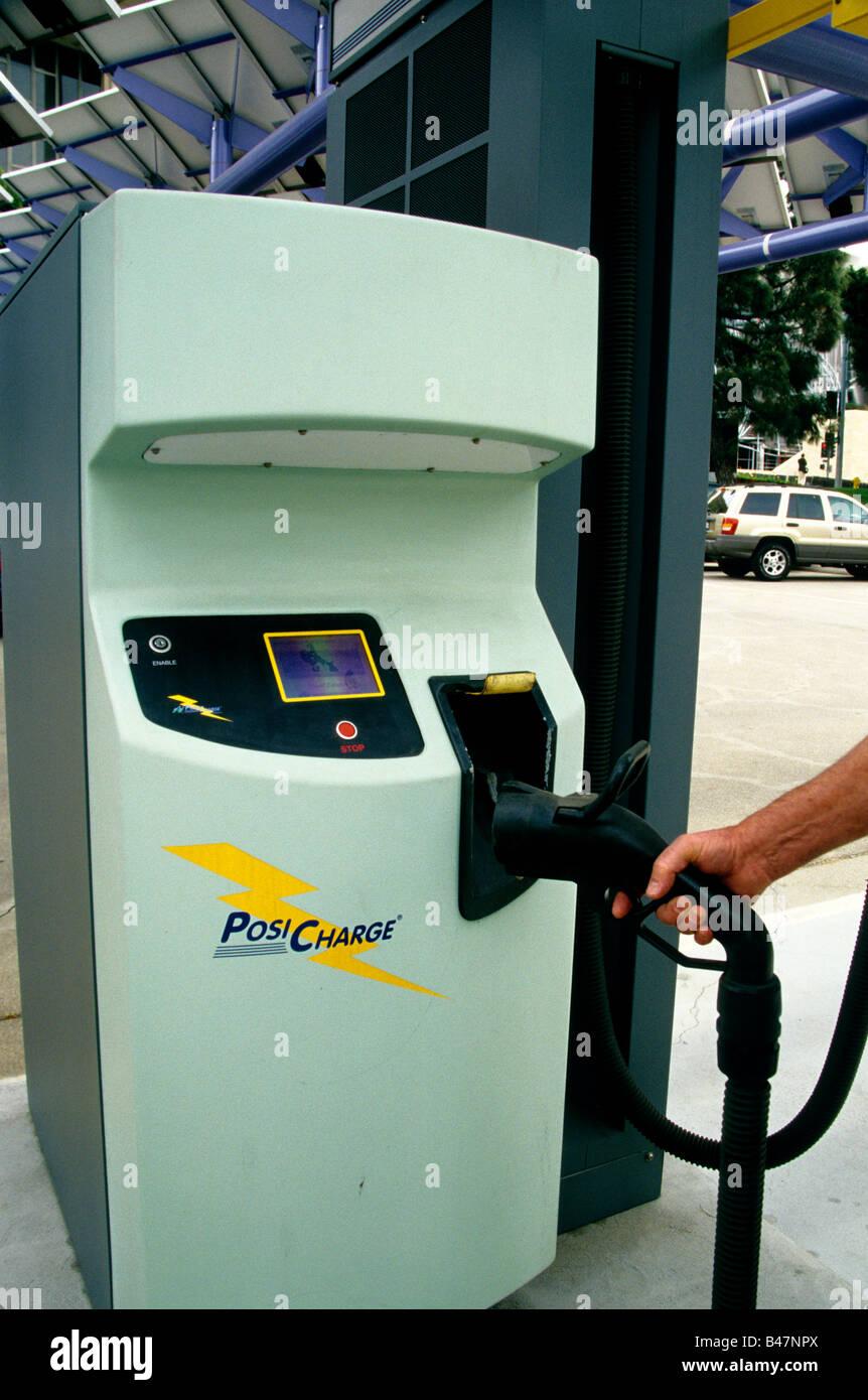 Electric vehicle 'Posi Charge' station. - Stock Image