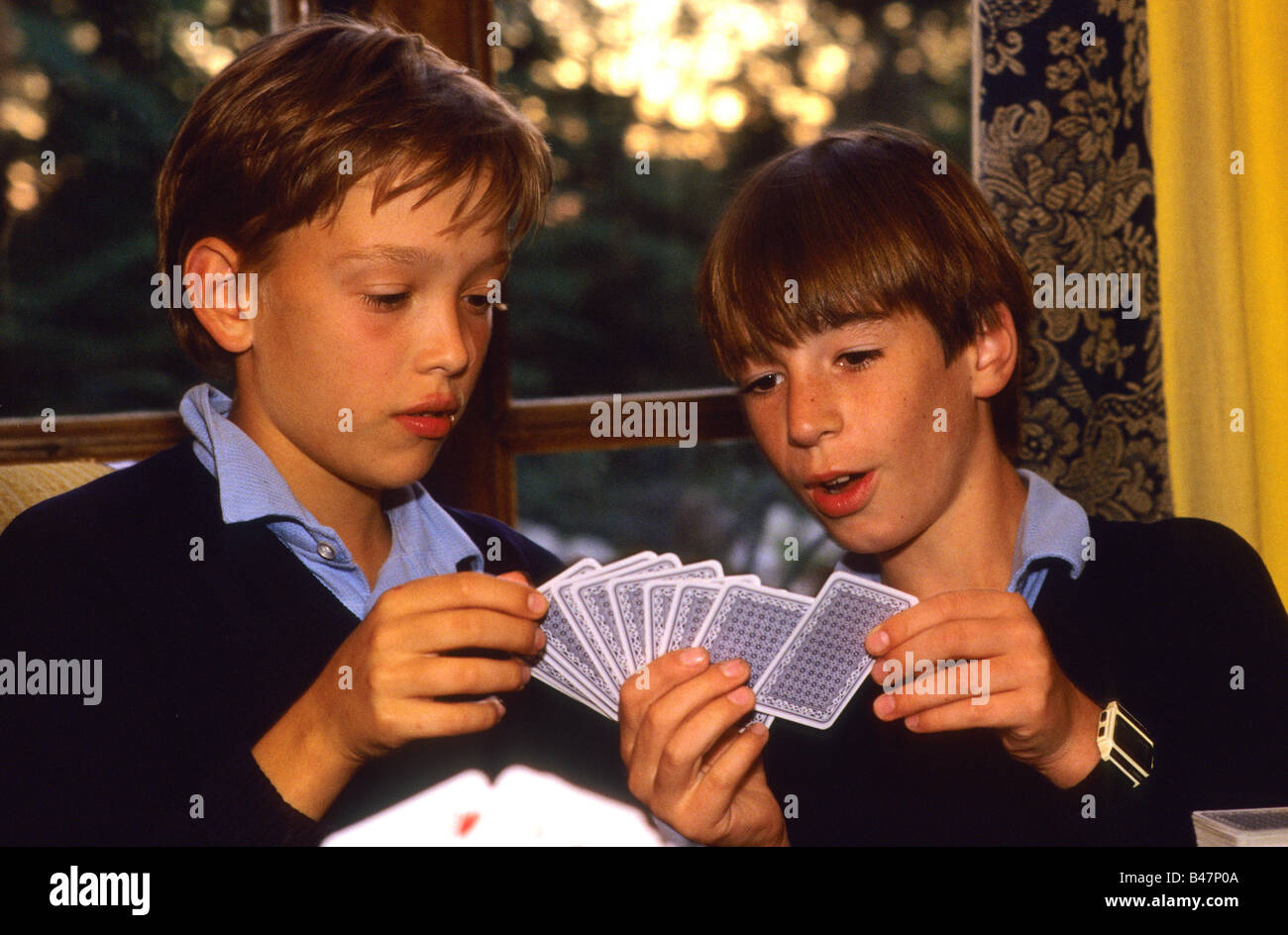 Two boys at Cothill School playing cards at the end of the school day - Stock Image