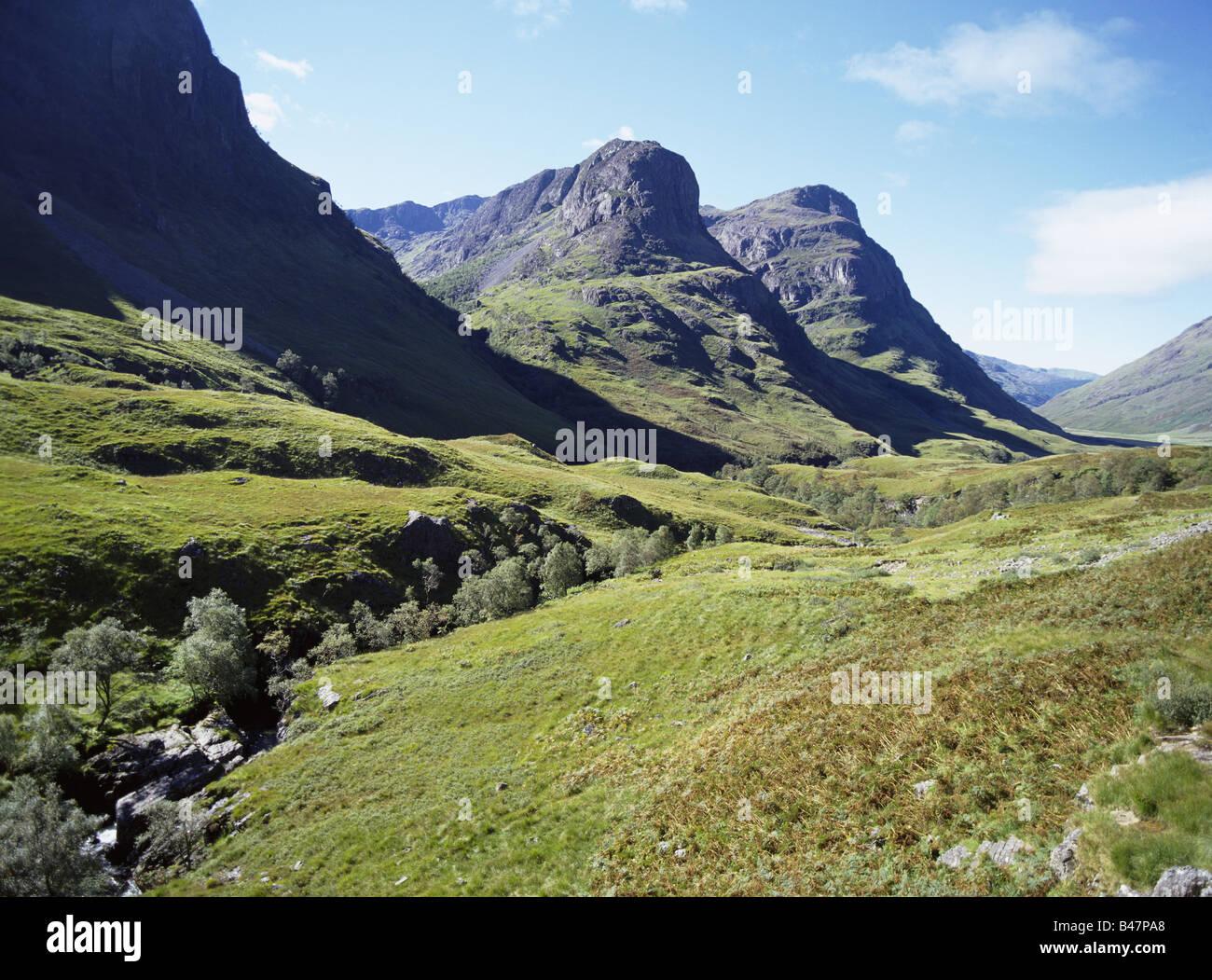 dh The Three Sisters glen coe GLENCOE ARGYLL Rugged Scottish valley craggy mountainous peaks scotland munros mountains Stock Photo