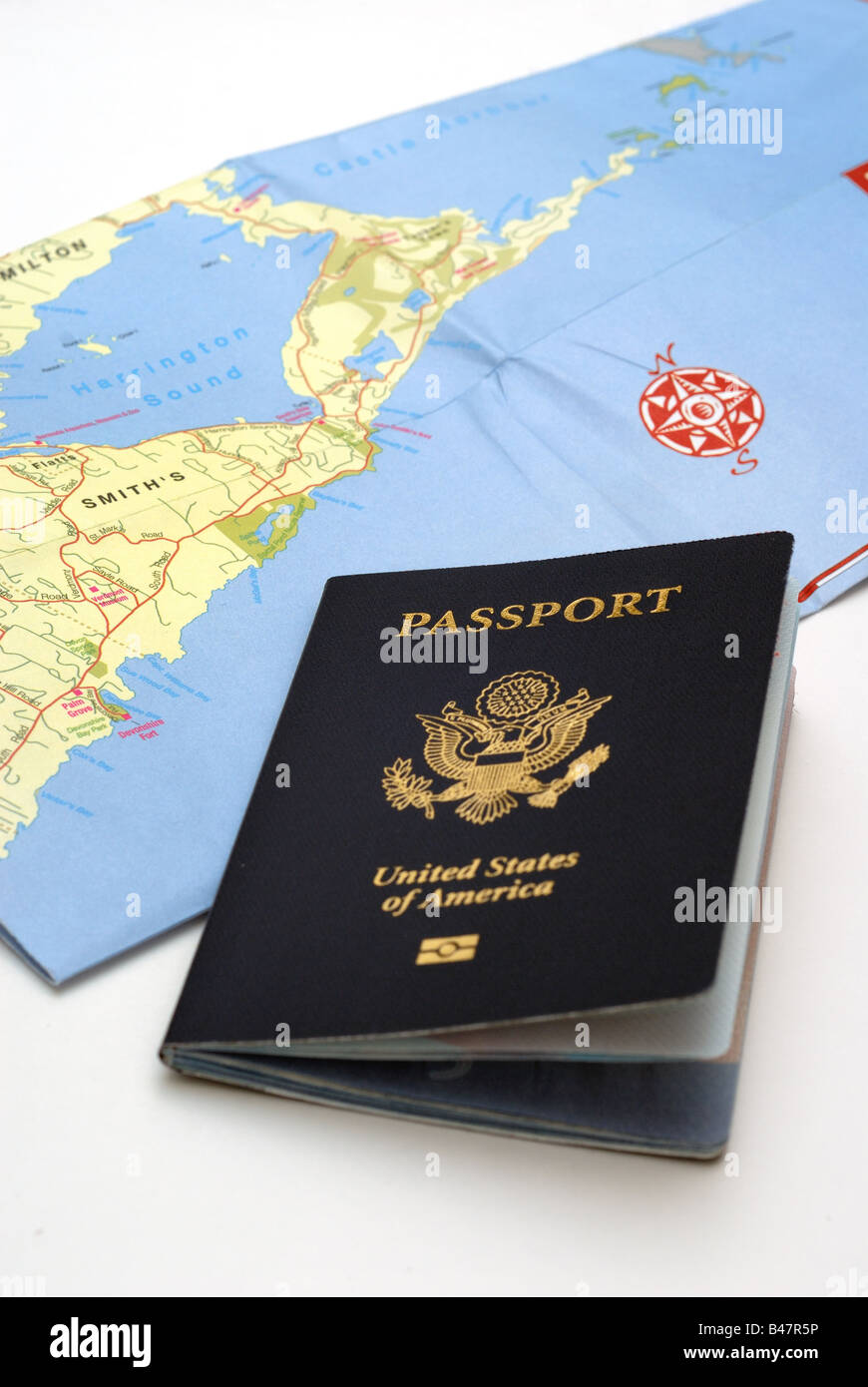 A United States Passport and a folded map of Bermuda illustrate the ...