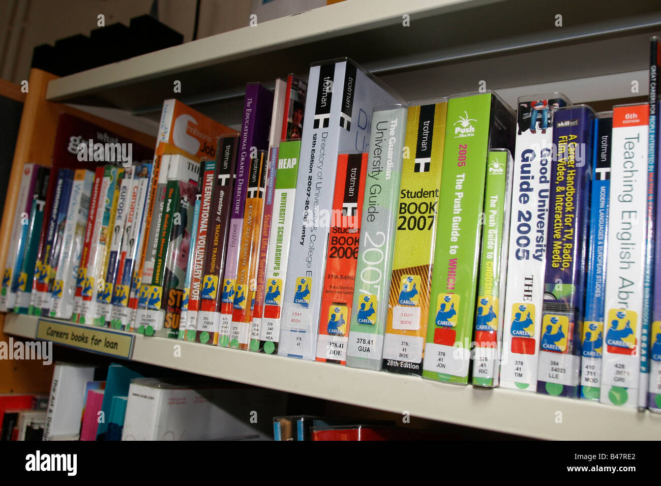 Sixth Form College Library Bookshelf With Student Directories And University Handbooks For Reference