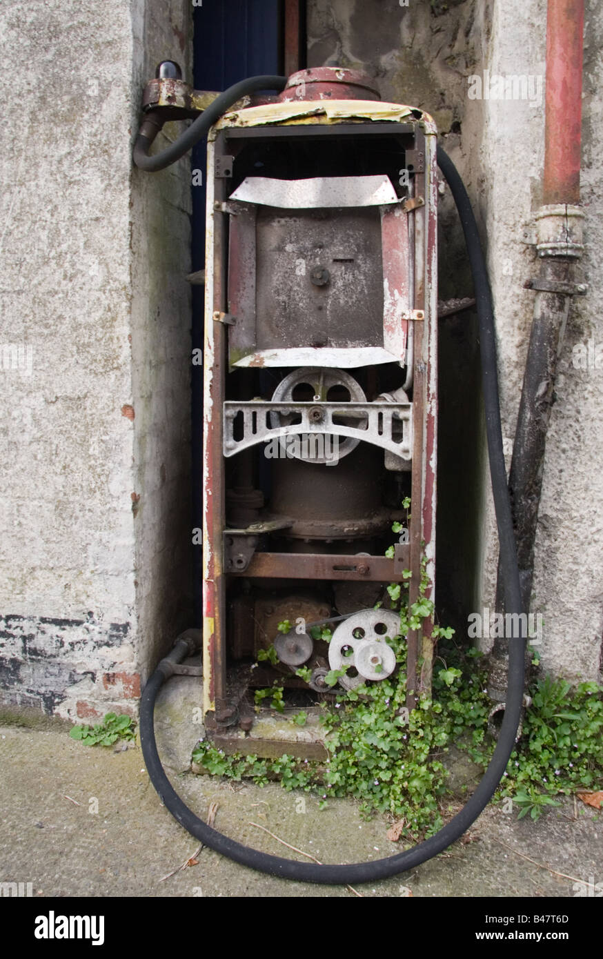 An old petrol pump in advanced state of disintegration, Laugharne, Carmarthen, Wales, UK - Stock Image