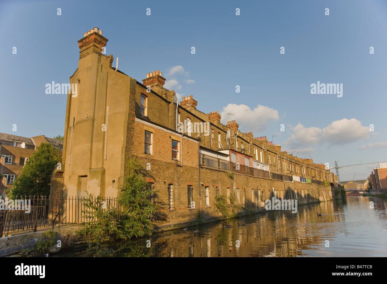 A row of terraced houses facing the Grand Union canal West London - Stock Image