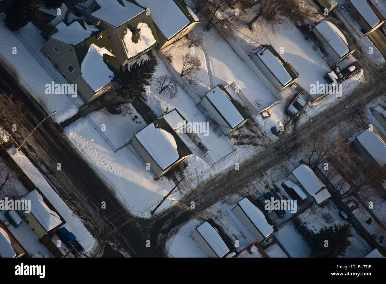 Snow covered rooftops - Stock Image