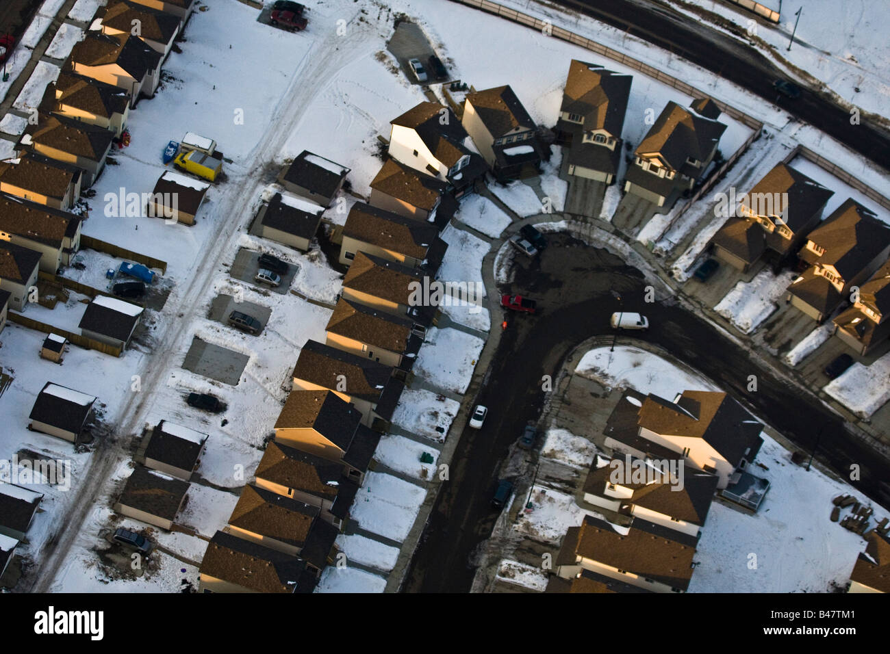 Aerial view of neighborhood in winter - Stock Image