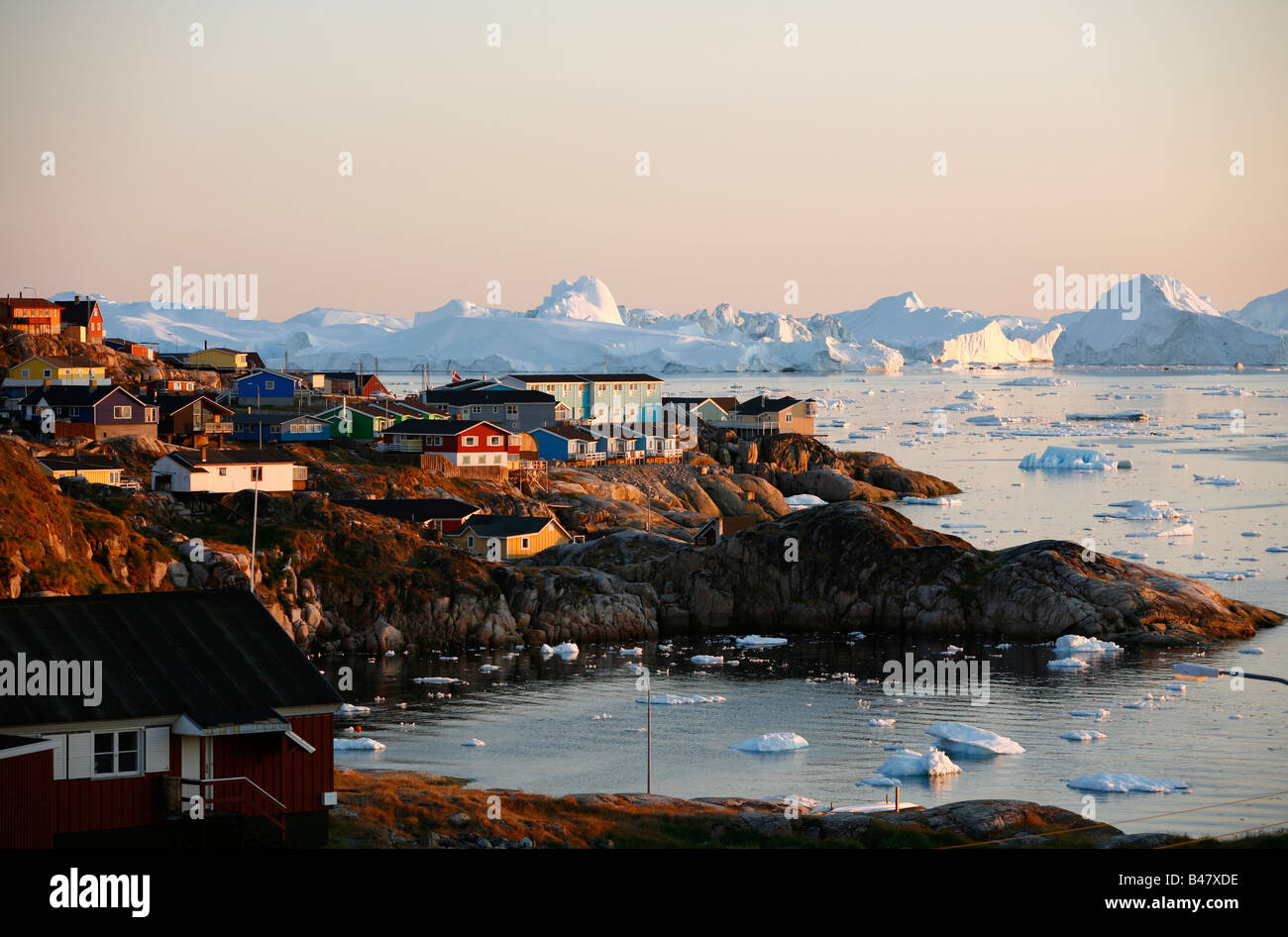 Aug 2008 - A view over houses and the Ilulissat Kangerlua Glacier also known as Sermeq Kujalleq Ilulissat Disko Stock Photo