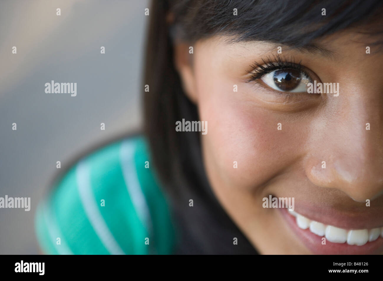 closeup of fifteen year old hispanic teenager looking at camera, girl, woman, latina latino southwestern united - Stock Image