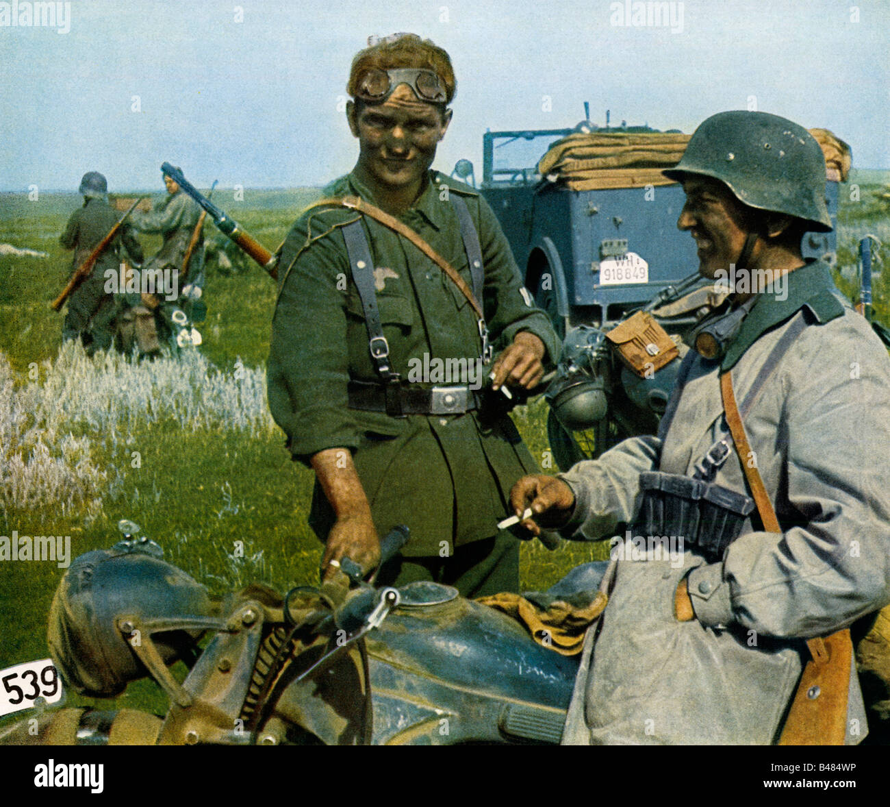 Wehrmacht Cigarette Break German motorcycle messengers on the Eastern Front in the Russian campaign in WW II - Stock Image