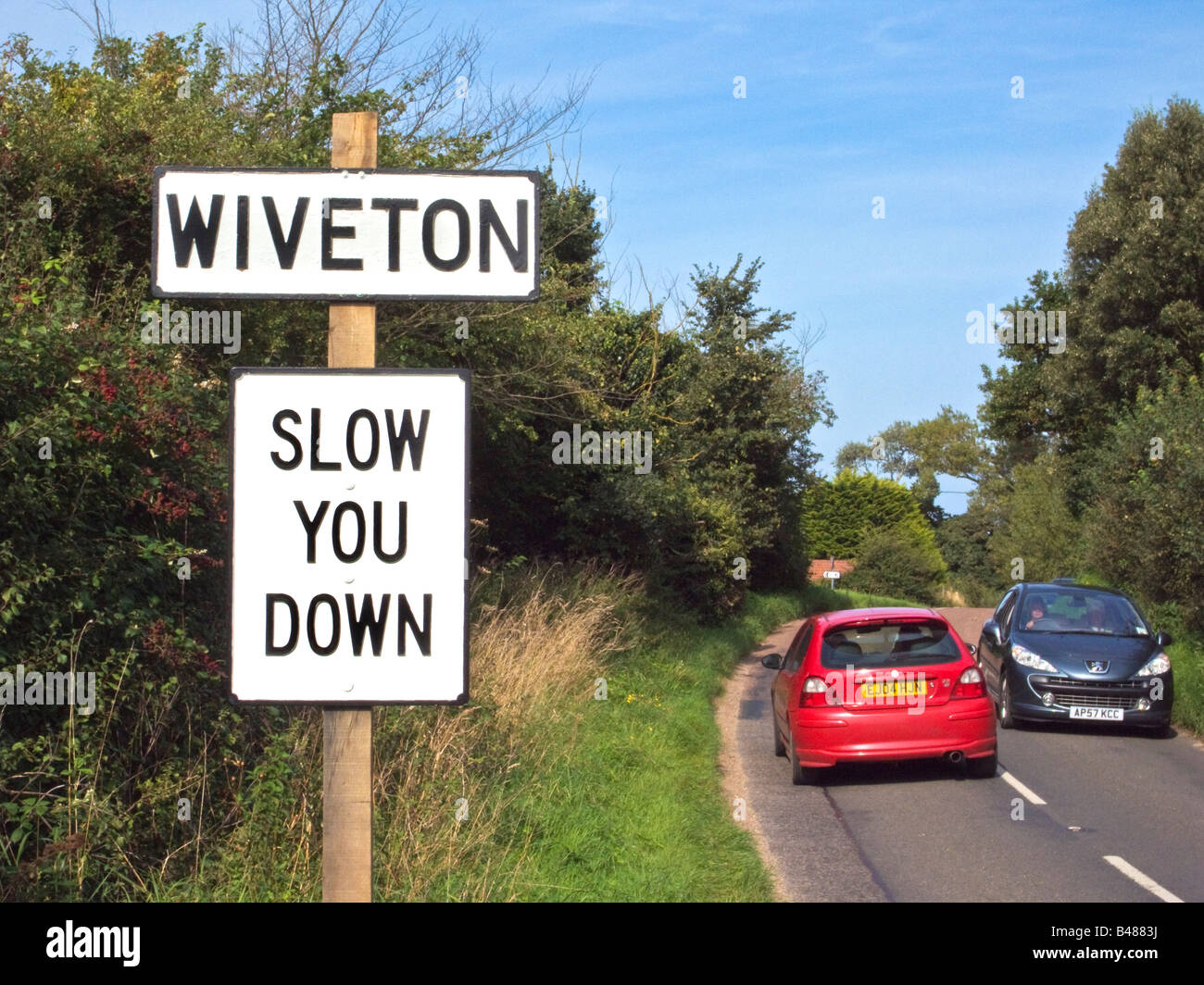 Amusing road sign SLOW YOU DOWN in Wiveton Norfolk East Anglia England UK EU - Stock Image