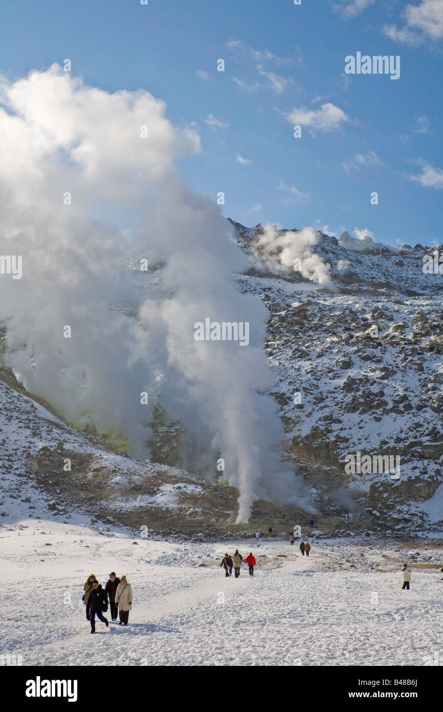 Akan National Park Hokkaido Island Japan Clouds of venting sulfur steam from a fumarole on Mt Iwo volcano in winter - Stock Image