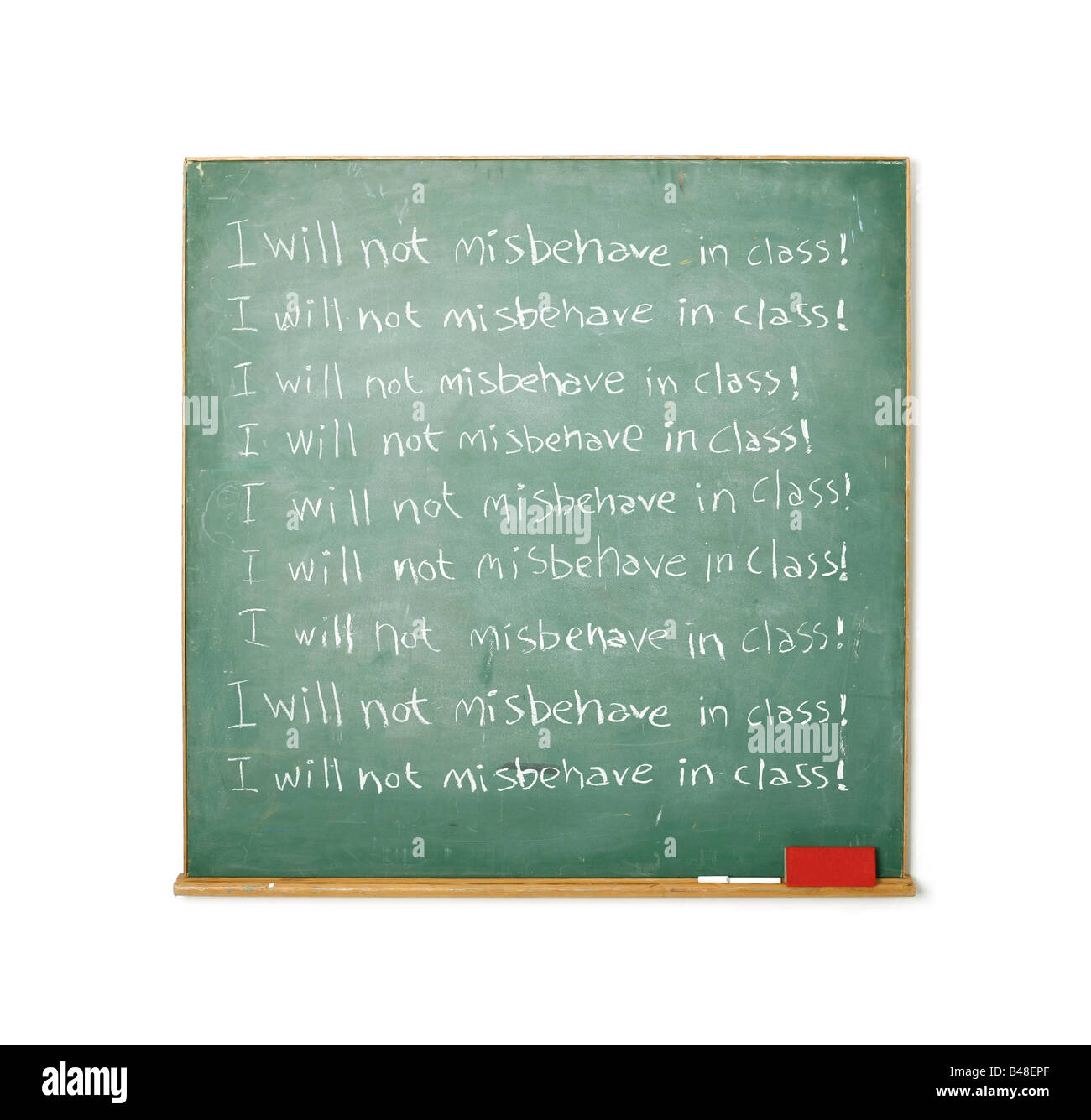 Blackboard with the message I will not misbehave in class written on it - Stock Image
